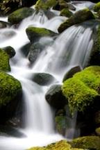 photo of water cascading through waterfalls