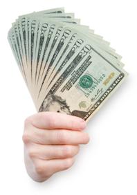 photo of hand holding many $20 bills