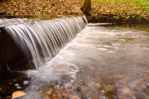 Photo of waterfall turning into river