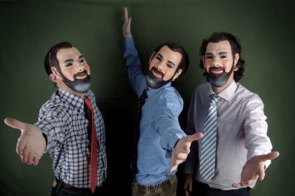 photo of three men wearing the same masks