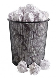 garbage pail full of crumpled paper
