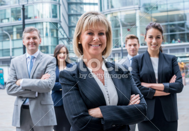 stock photo of smiling faces of executives