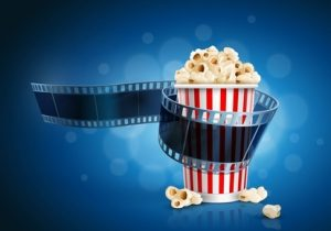 Camera film strip and popcorn on blue defocus background. Detailed vector illustration. Elements are layered separately in vector file. EPS10.