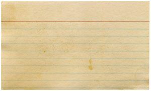 Photo of a yellowed blank index card. Index cards are an option to organize your research.