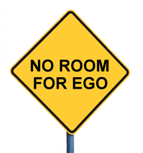 yellow road sign saying No room for ego - explains one of 10 writing tips