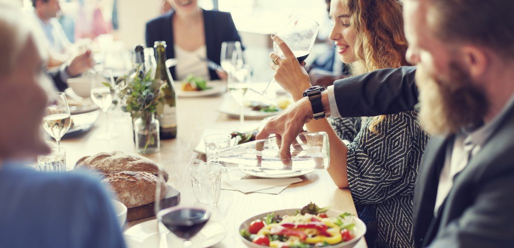 article explains how being at a dinner party like people in photo is like writing a white paper
