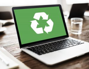 That White Paper Guy | recycle logo on laptop screen signifies repurposing content online