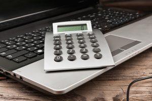 photo of calculator on top of keyboard
