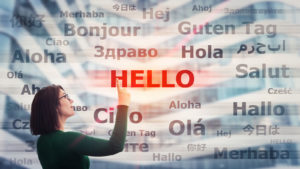 Photo of woman pointing to Hello in many languages