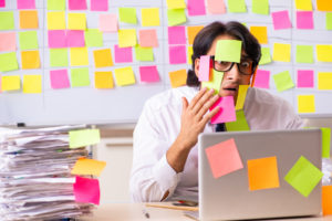 photo of developer with postits all over to show conflicting priorities