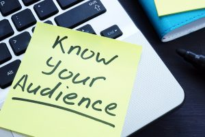 "photo of yellow sticky note saying ""know your audience"""