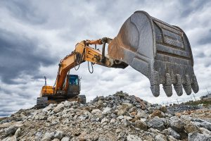 Photo of excavator machine getting ready to dig