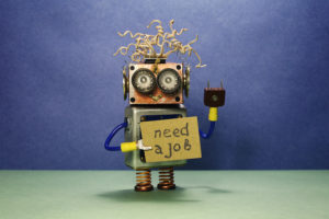 Robot holding need a job sign