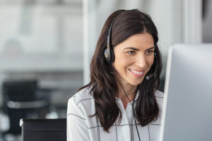 Text-to-speech--Woman listening as computer reads her white paper back to her