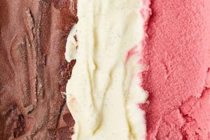 Neapolitan ice cream representing all 3 flavors of white papers