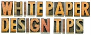 white paper design spelled out in wooden letters