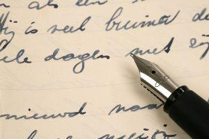 photo of fountain pen on handwritten letter